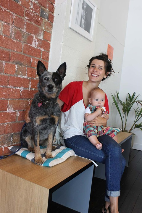 Dog at the vet with mum and baby